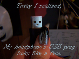 My headphone's USB has a face by GingaAkam