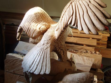 Woodcarver Eagle in progress10 making feather by woodcarve