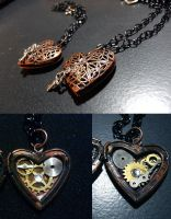 metal heart locket by TayaRavena