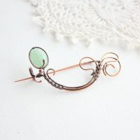 Light green brooch by WhiteSquaw