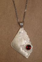 Textured Sterling Silver pendant with Garnet Cab by Utinni