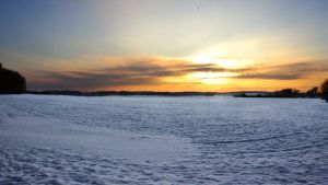 sunset over snowy field by MisanthropicBastard
