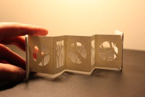 miniature book papercut out/branches by izibel1