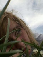 Laying in the Grass by TheBlondeGinger