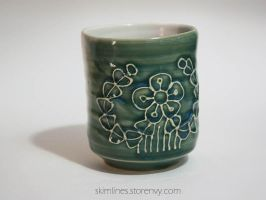 Glorious flower with bira tea cup by skimlines