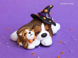 Beagle puppy snuggling with kitty by SculptedPups