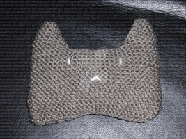 Handknitted cat cushion by AKRY