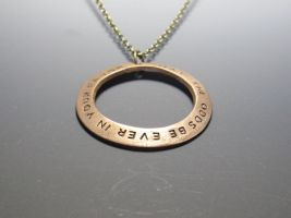 Hunger Games bronze pendant by Peaceofshine