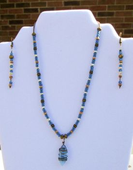 Teal and brass necklace and earrings by Hawksong76