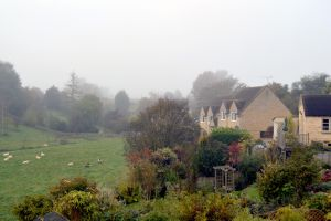 View Over A Misty Valley From A Garden In Tetbury by aegiandyad