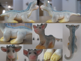 Clay baby eastern dragon by WaterGleam