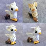 Baby Gryphons by DragonsAndBeasties