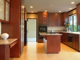 A kitchen with woodwork done by Furniture experts  by queenanneupholstery