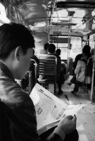 Reading on the bus by avotius