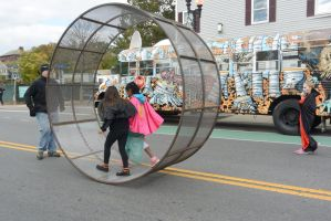 The Human Hamster Wheel Rolling Down the Street 3 by Miss-Tbones