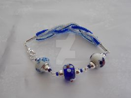 Blue and white charm and seed bead bracelet 342a by Quested-Creations