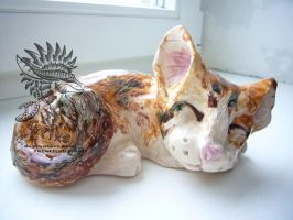 Clay sleeping cat sculpture by Drerika