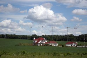 Houses and wind turbines stock by croicroga