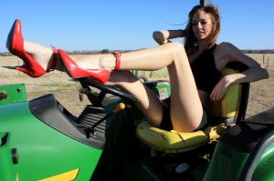 Tina on Tractor by StilettoStudios