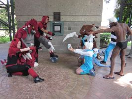 A-Kon 23: Pokemon shoot: Magma vs. Aqua by Inept-Evil-Genius