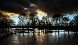 Sunset over the Hereford floods by Fizaaa