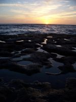 Tidepools at sunset by scientificartist