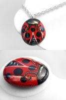 Ladybug Pendant Necklace and Stone by sobeyondthis