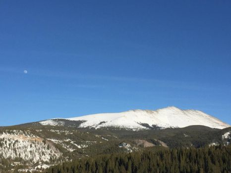 The Moon hanging over the Rocky Mountains  by LouisChaplan