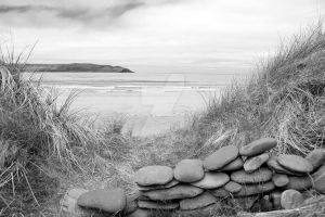 stone wall shelter on a beautiful beach in black a by morrbyte