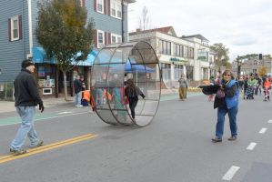 The Human Hamster Wheel Rolling Down the Street 2 by Miss-Tbones