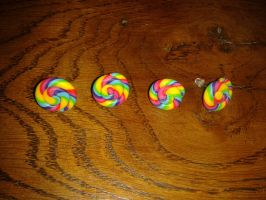 Rainbow spiral studs by MeticulousBlue