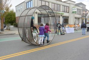 The Human Hamster Wheel Rolling Down the Street 9 by Miss-Tbones