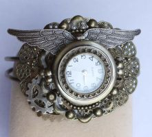 Winged steampunk watch by Pinkabsinthe