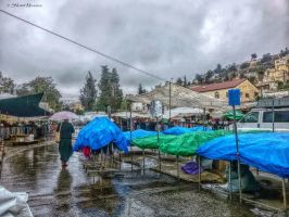 In the market on a rainy day by ShlomitMessica
