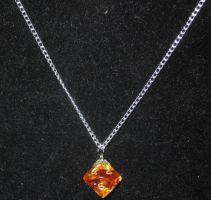 Red and gold magma ten-sider pendant by BlackUnicornWood