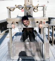 In the stocks by cello--blood