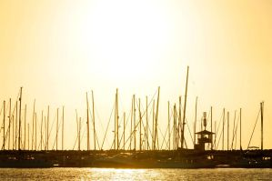Boats at sunset by eddieretelj