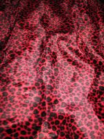 Red Leopard Print by AsphyxiaStock