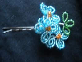 blue flower hairclip close up by thewind1152