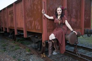 [STOCK] Steampunk Girl sitting on a wagon by AyraLeona