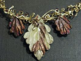 ceramic leaves in gold by DPBJewelry
