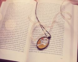 Pendant and literature by nabey