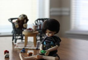 A Boy and His Toys by haiiro