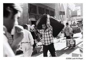 Man carrying suitcase by lmajali