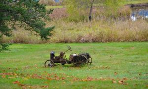 Old Tractor in a field by ShannonCPhotography