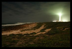 Lighthouse by night by braticus
