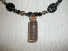 Close Up of Black Wolf Necklace Bottle Pendant by DaybreaksDawn