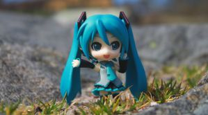 Miku with grass. by Migon21