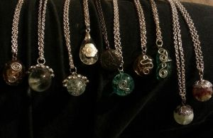 marbles and glass metalwork necklaces by DevastationRises