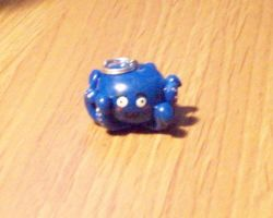 Octopus charm by BloodStainedSilk